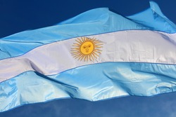 Argentinian flag waving against the blue sky, Argentina
