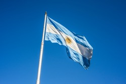 Argentinian flag waving in Buenos Aires, Argentina.