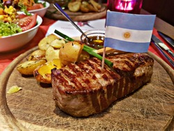 argentinian rump steak with side dishes and argentinian flag