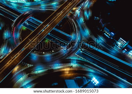 Arial top view of Modern transportation with Expressway, Road and Roundabout,Road traffic, multilevel junction highway-Top view in  asia. Important infrastructure for transport.  ストックフォト ©