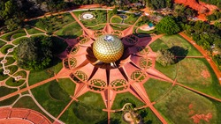 Arial View of Auroville. Auroville is an experimental township in Viluppuram district mostly in the state of Tamil Nadu, India with some parts in the Union Territory of Puducherry in India