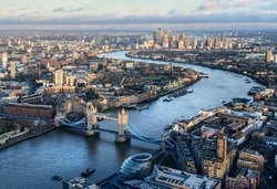 Arial view of London with the River Thames and Tower Bridge at sunset