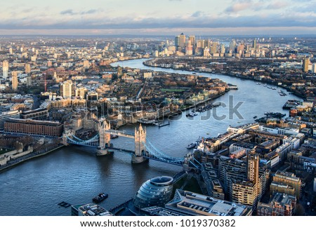 Arial view of London with the River Thames and Tower Bridge at sunset #1019370382
