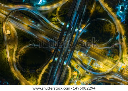 Arial view of Modern transportation with Expressway, expressway payment point, Road and Roundabout, multilevel junction highway-Top view. Important infrastructure.