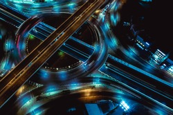 Arial view of Modern transportation with Expressway, Road and Roundabout,Road traffic, multilevel junction highway-Top view in  asia. Important infrastructure for transport.