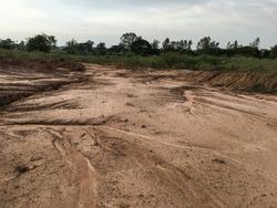 Arid landscape in thailand. Soil erosion. Soil erosion