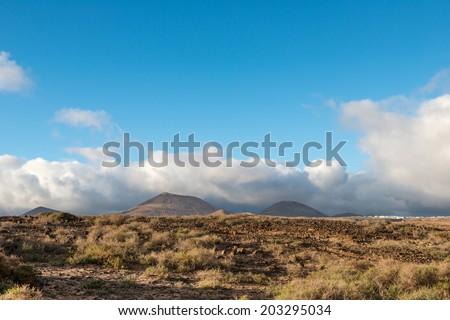 Arid landscape with volcanoes, in Timanfaya National Park, Lanzarote, Spain