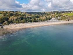 Ariel coastal image of Wisemans Bridge beach, Pembrokeshire, Wales, UK | Sandy beaches with calm ocean waters.