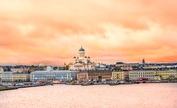 Ariel panoramic view of  Helsinki at sunset with a Cathedral church and  Market Square area on the shore of Baltic Sea in Helsinki, Finland.