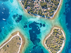 Ariel view of popular Blue Lagoon - Krknjasi near town Trogir, in the Adriatic sea, Croatia