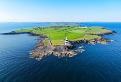 Ariel view of the Hook Lighthouse situated on Hook Head at the tip of the Hook Peninsula in County Wexford, Ireland.