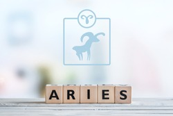 Aries star sign on a wooden table