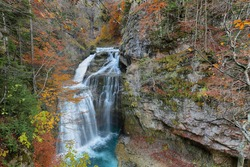 Aripas waterfall in an autumn scene in Ordesa and Monte Perdido National Park, Huesca province, Spain