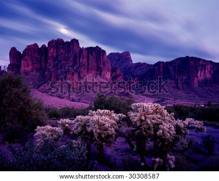 Arizona desert with moon behind clouds