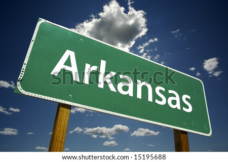 Arkansas Road Sign with dramatic clouds and sky. - stock photo
