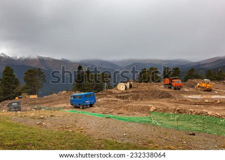 ARKHYZ, KARACHAY-CHERKESSIA, RUSSIA - OCTOBER 10 2014: Construction of ski resort Arkhyz park. First part of cable car line is fully functional. This fall part of resort is ready for guests.
