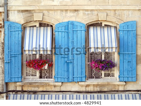 Arles (Provence, France) - Two windows of a house in front of Les Arenes