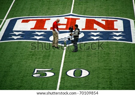 ARLINGTON - JAN 26: In preparation for Super Bowl XLV an unidentified cameraman and worker discuss placement of the trophy in Cowboys Stadium in Arlington, TX. Taken January 26, 2011 in Arlington, TX.