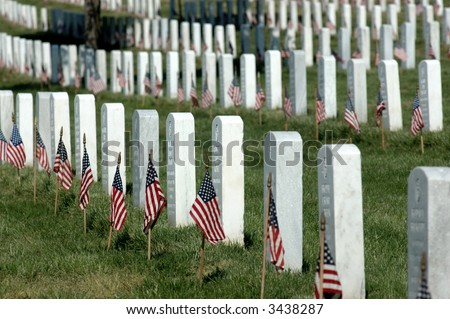 Arlington National Cemetery headstones with American Flag on each