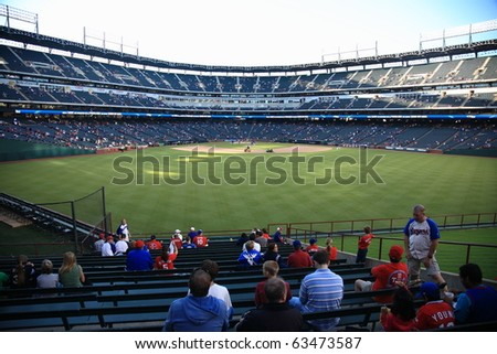 ARLINGTON, TEXAS - SEPTEMBER 27: Fans watch pregame activities at the Ballpark in Arlington before a game between the Rangers and Seattle Mariners on September 27, 2010 in Arlington, Texas.