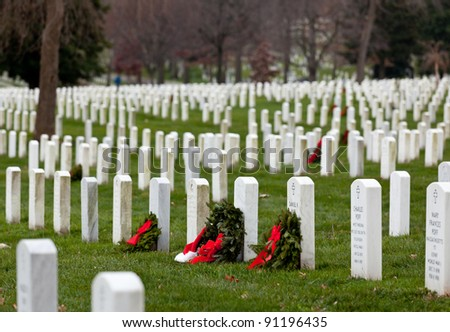 ARLINGTON, VA - DECEMBER 18: Christmas wreaths on gravestones in Arlington National Cemetery on December 18, 2011. The wreathes have been donated each year since 1992.