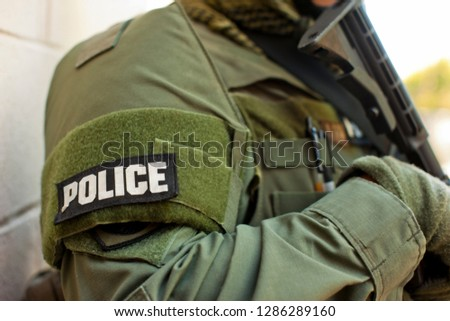 Arm band on the uniform of a military policeman.
