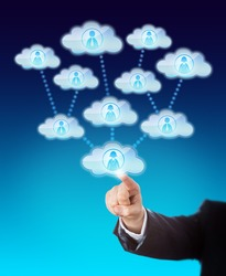 Arm of a business man accessing the support of many knowledge workers. His index finger is touching a cloud icon that is linked to several other clouds. Metaphor for cloud sourcing and scalability.