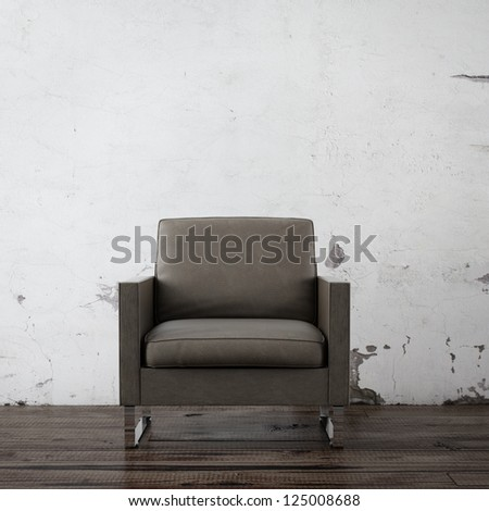 Armchair in empty room with concrete wall - stock photo