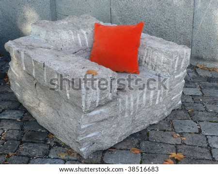 Armchair of blast rock with red pillow