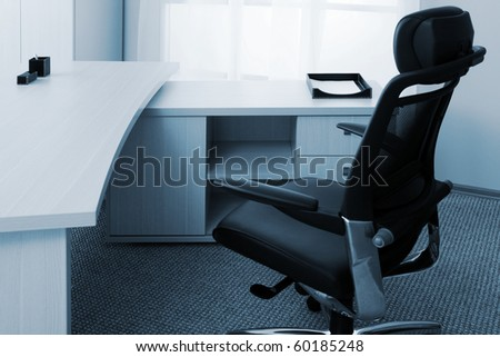 Armchair of director on a background of a window