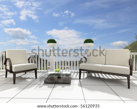 Armchairs and a table on an open terrace