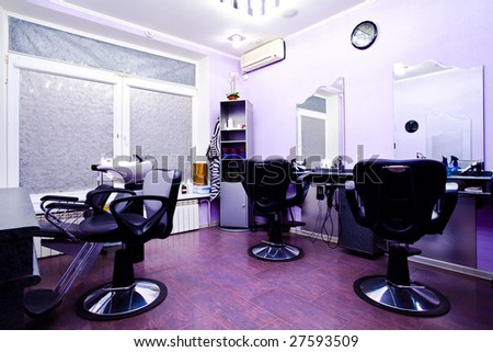Armchairs in hairdressing salon interior