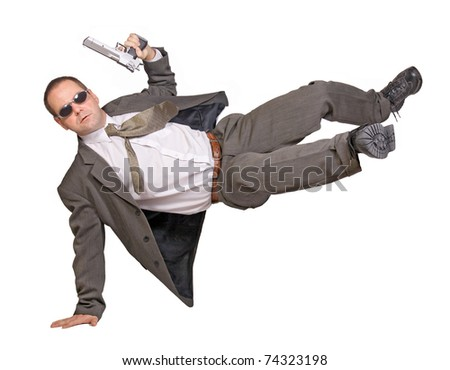 armed man in a suit jumping