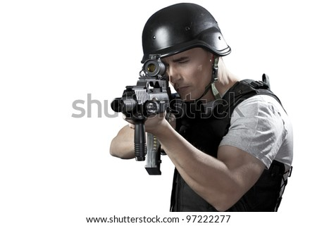 Armed man in protective cask with a pistol. Isolated on white.