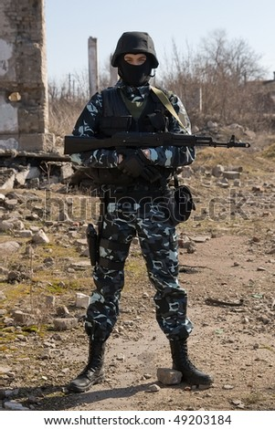 Armed officer with an automatic rifle in full ammunition