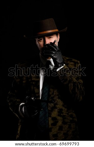Armed robber with a gun smoking a cigar.
