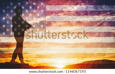 Armed soldier with rifle standing and looking on horizon. USA flag. Silhouette at sunset. War, army, military, guard.