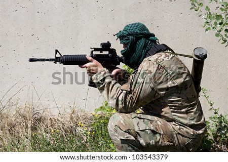 armed terrorist, freedom fighter, a masked killer