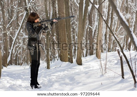 Armed woman in the forest target at victim