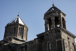 Armenia, Gyumri. Holy Church Yot Verq, means Seven wounds. The cupolas of Armenian apostolic church shot in winter season. Orthodox Architectural heritage. Stone engravings on walls
