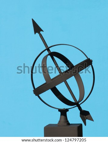 Armillary Sphere silhouetted against a blue background