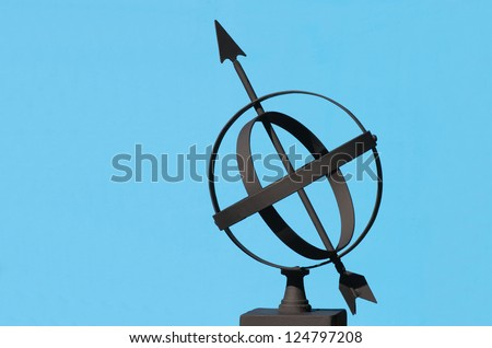Armillary Sphere silhouetted against a blue background - stock photo