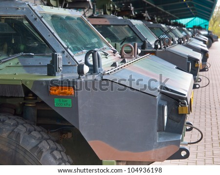 Armored army vehicles lined up in formation