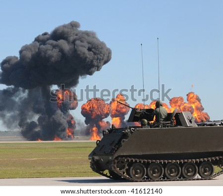 Armored vehicle in ground battle with explosions ans smoke