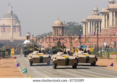 Armored vehicles driving down the Raj Path in preparation for Republic Day Parade, New Delhi, India - stock photo