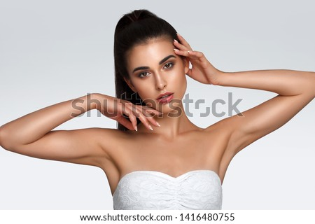 Armpit skin care, hair removal and hair removal concept, smooth clean soft skin. The woman raised hands up
