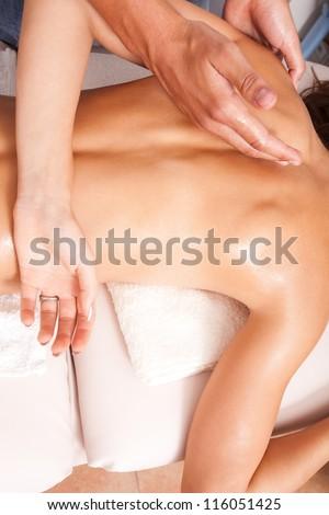 arms and upper back massage technique in spa salon