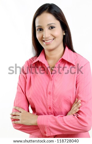 Arms crossed business woman against white - stock photo