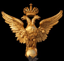 Arms of the Russian Federation isolated on a black background. This eagle is established on Hermitage collars