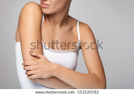 arms pain. beautiful woman...